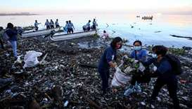 Volunteers participate in collecting garbage from Manila bay during the 33rd International Coastal C