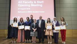 The award winners with the university officials