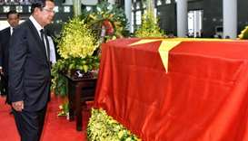 Cambodia's Prime Minister Hun Sen pays his respects infront of the coffin of late Vietnamese preside