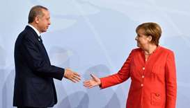 German Chancellor Angela Merkel greets Turkey's President Recep Tayyip Erdogan