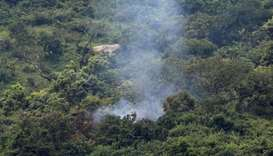 Smoke is seen at the site where two Nigerian military planes were involved in an accident while rehe