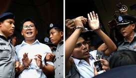Reuters journalists Wa Lone (L) and Kyaw Soe Oo depart Insein court after the verdict announcement i