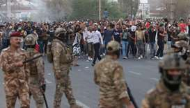 Iraqi protestors demonstrate yesterday against the government and the lack of basic services in fron