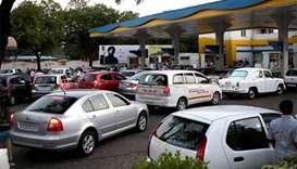 As petrol prices soar, Indians look for ways to ease pain
