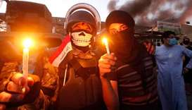 Iraqi protesters set fire to government buildings in Basra