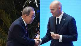 Former UN head Ban Ki-moon (L) shakes hands with Patrick Verkooijen, CEO of the Global Center on Ada