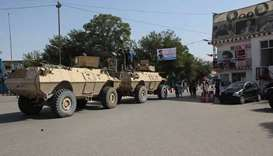 Afghan soldiers gather at a street in Kunduz