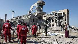 Red Crescent medics stand at the site of Saudi-led air strikes on a Houthi detention centre in Dhama