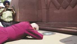 Archbishop of Canterbury, Justin Portal Welby, prostrates at the site of the Jallianwala Bagh massac