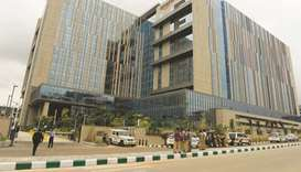 Police stand guard at the entrance of Amazon's newly inaugurated largest campus building in Hyderaba