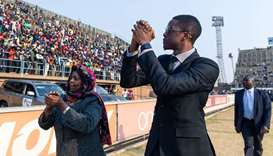Robert Mugabe Jnr, son of late former Zimbabwean president Robert Mugabe, salutes the crowd gathered