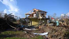 Debris lies around a damaged home in the aftermath of Hurricane Dorian in Treasure Cay on Abaco isla
