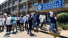 Zimbabwe junior doctors stage a protest march at Parirenyatwa Hospital in Harare protesting the alle