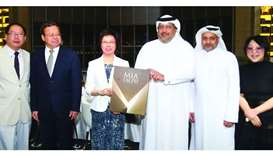 Gulf Times Editor-in-Chief Faisal Abdulhameed al-Mudahka presents a memento to Minister HE Yin Yicui