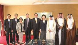 Shura Council members along with Chinese delegation pose for a photo.