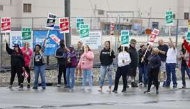 United Auto Workers (UAW) members picket at a gate at the General Motors Flint Assembly Plant after