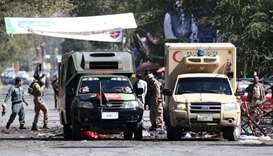 Afghan security forces at  the site of a blast in Kabul