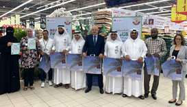 MME and Carrefour Qatar officials mark the occasion.