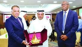 Qatar Chamber board member Mohamed bin Ahmed al-Obaidli hands over a token of recognition to South A