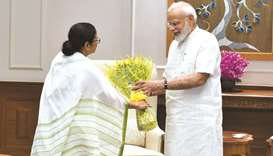 West Bengal Chief Minister Mamata Banerjee presents a bouquet of flowers to Prime Minister Narendra