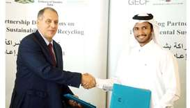 Dr Yury Sentyurin (left) and Abdallah al-Suwaidi at the signing ceremony in Doha for environmental s