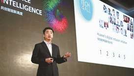 Ken Hu speaking at the TECH4ALL Summit.