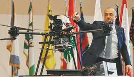 Lebanese Minister of Defence Elias Bou Saab points at a part of an Israeli captured drone at a press