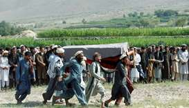 Men carry a coffin of one of the victims after a drone strike, in Khogyani district of Nangarhar pro