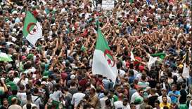 Algerian protesters take part in a demonstration against the country's army chief in Algeria's capit