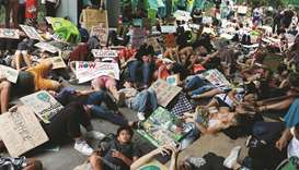 Young climate strikers storm into Thai environment ministry