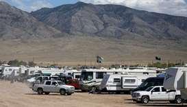 Participants arrive to an RV camp as an influx of tourists responding to a call to 'storm' Area 51,