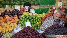 An Iranian fruit vendor adjusts his fruit shop in the Tajrish Bazaar in capital Tehran