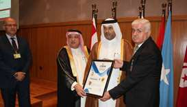 Qicca board member Dr Sheikh Thani bin Ali al-Thani receiving the title in Kuwait.