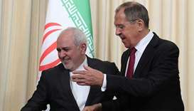 Russian Foreign Minister Sergei Lavrov (R) and his Iranian counterpart Mohammad Javad Zarif attend a