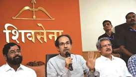Shiv Sena chief Uddhav Thackeray addresses a press conference in Mumbai on Friday. He is flanked by