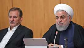 President Hassan Rouhani (R) chairing a cabinet meeting in the capital Tehran on September 18.