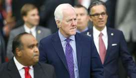 Texas Senator John Cornyn enters the stadium to attend the 'Howdy Modi!' event.