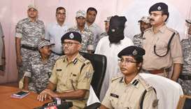 Al Qaeda's militant Mohamed Kalimuddin Mujahiri is guarded by security personnel as senior police of