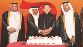 Dignitaries at the ceremonial cutting of the cake. PICTURES: Noushad Thekkayil