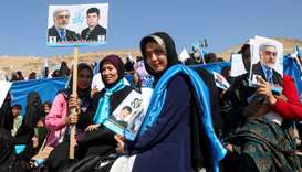 Supporters of Afghanistan's presidential candidate Abdullah Abdullah attend the presidential electio