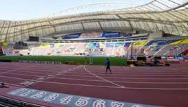 A man walks inside the Khalifa International Stadium in Doha ahead of the IAAF World Athletics Champ