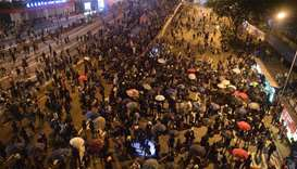 Protesters occupy a main road outside the central government offices (R) in the Admiralty area in Ho