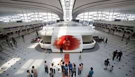 People are seen at the terminal hall of the newly launched Daxing International Airport on the outsk