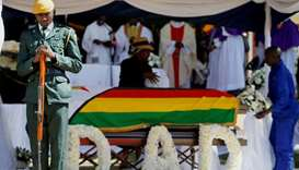 Soldier stands over the coffin of former Zimbabwean President Robert Mugabe during a church service
