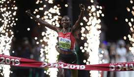 Kenya's Ruth Chepngetich crosses the line to win the race