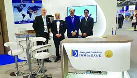 Doha Bank CEO Dr R Seetharaman and the rest of the Doha Bank team at 'Sibos 2019'.