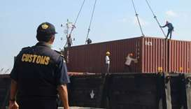 This file photo dated July 29, 2019 shows Indonesian custom officers preparing to return containers