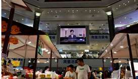 A news conference of Hong Kong's Chief Executive Carrie Lam is televised in a shopping mall in Hong