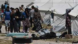 Migrants deplore conditions in new Greek camp