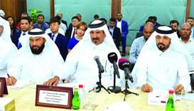 Qatar Chamber first vice chairman Mohamed bin Towar al-Kuwari (centre) is joined by (from left) Qata
